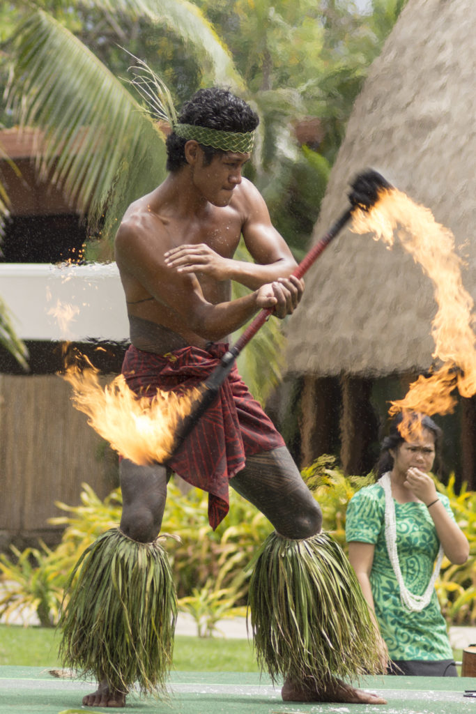 The art of fire dancing, performed at the Polynesian Cultural Center, is exciting both day and night.